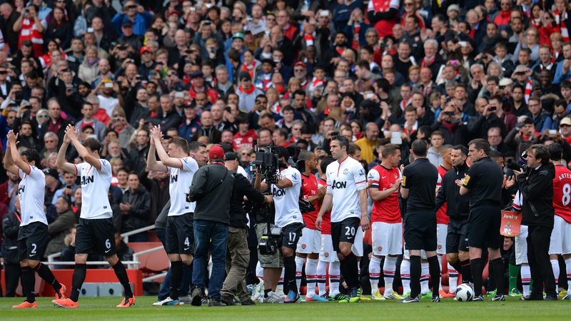 Robin van Persie of Manchester United walks out as the Premier League champions Manchester United are given a guard of honour by Arsenal