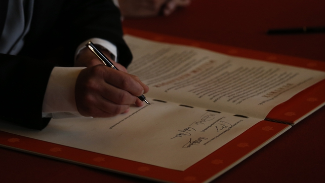 Prince Willem-Alexander of the Netherlands signs the Act of Abdication