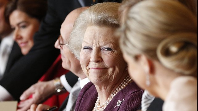 Queen Beatrix of the Netherlands smiles at Princess Maxima