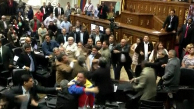The fracas came after the Assembly passed a measure denying opposition members the right to speak until they publicly recognised President Nicolas Maduro