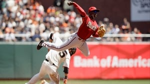 Didi Gregorius of the Arizona Diamondbacks takes flight against the San Francisco Giants at AT&T Park in San Francisco