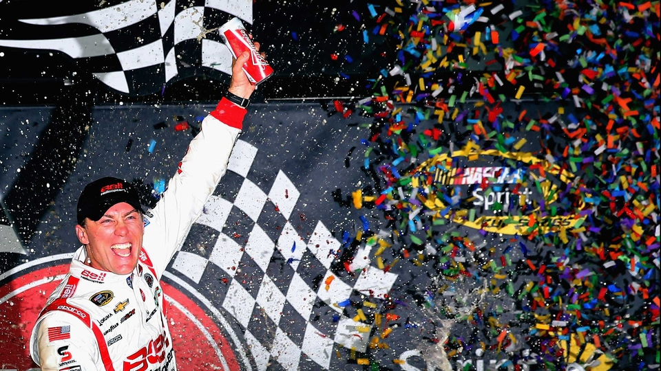 Kevin Harvick celebrates after winning the NASCAR Sprint Cup Series Toyota Owners 400 in Richmond, Virginia