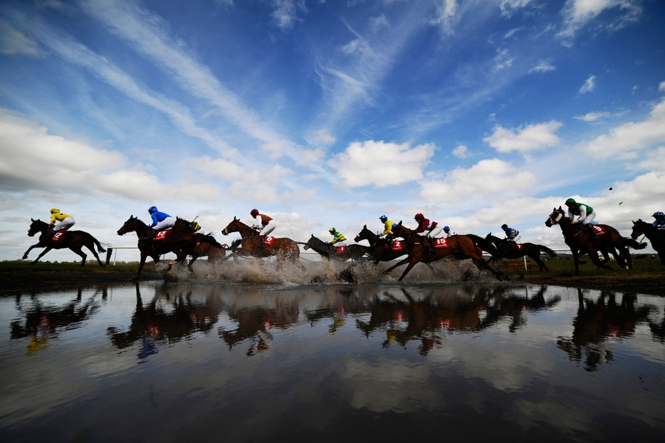 Runners make their way through 'Joe's Water Splash' at Punchestown racecourse in Naas