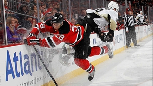 Anton Volchenkov of the New Jersey Devils hits Pascal Dupuis of the Pittsburgh Penguins  at the Prudential Center in Newark, New Jersey