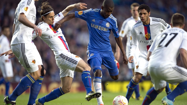 Ramires tries to get a shot off with Basel's Kay Voser in close attendance