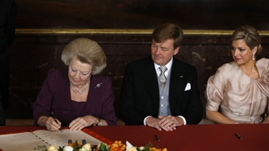 Queen Beatrix signs the Act of Abdication under the eyes of her son, Prince Willem-Alexander in the Mozes hall of the Royal Palace in Amsterdam