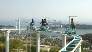 Tourists ride a pedal-powered sky cycle rollercoaster at Washuzan Highland Amusement Park in Japan