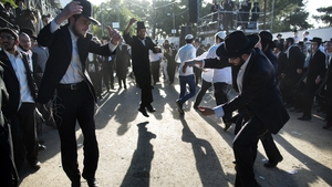 Ultra-Orthodox Jews dance during a ceremony at the grave site of Rabbi Shimon Bar Yochai in the northern Israeli village of Meron