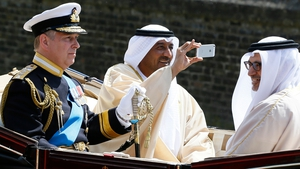 Sheik Ahmed bin Saeed Al Maktoum takes a picture on his phone during a visit to Britain