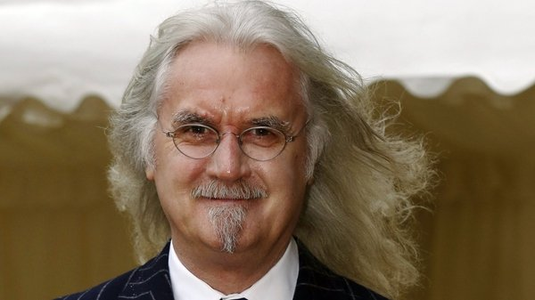 Billy Connolly said he had not realised the photographer was a woman as he could only see her in the shadows