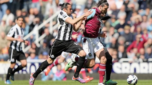 West Ham's Andy Carroll tries to escape the attention of Jonaz Gutierrez