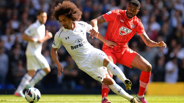 Benoit Assou-Ekotto of Tottenham Hotspur is marshalled by Southampton's Guilherme do Prado