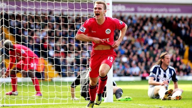 Callum McManaman of Wigan celebrates after scoring the winner.