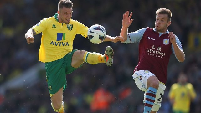 Anthony Pilkington of Norwich City tangles with Villa's Andreas Weimann