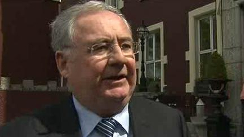 Pat Rabbitte has ruled out the removal of the €500,000 cap on bankers' pay