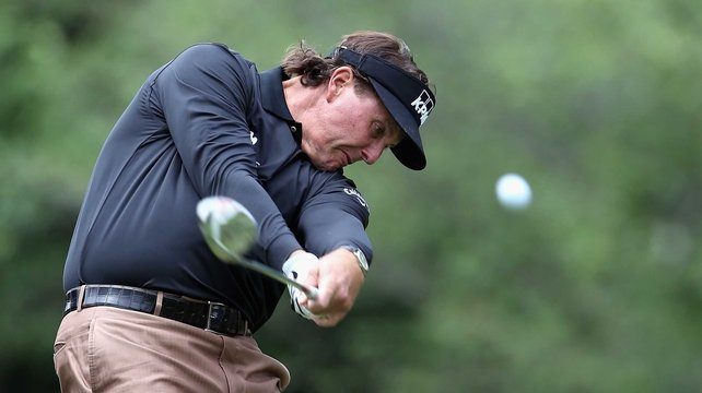 Phil Mickelson shot a one over 73 but holds a share of the lead going into the final day