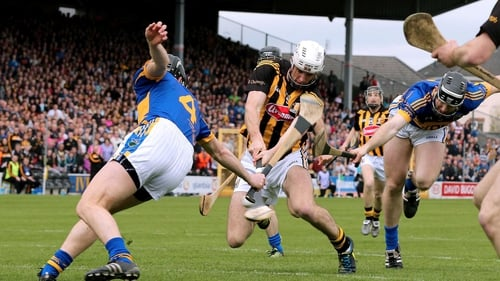 Kilkenny's Michael Fennelly scores the opening goal of the NHL final despite the efforts of Paul Curran and Conor O'Mahony