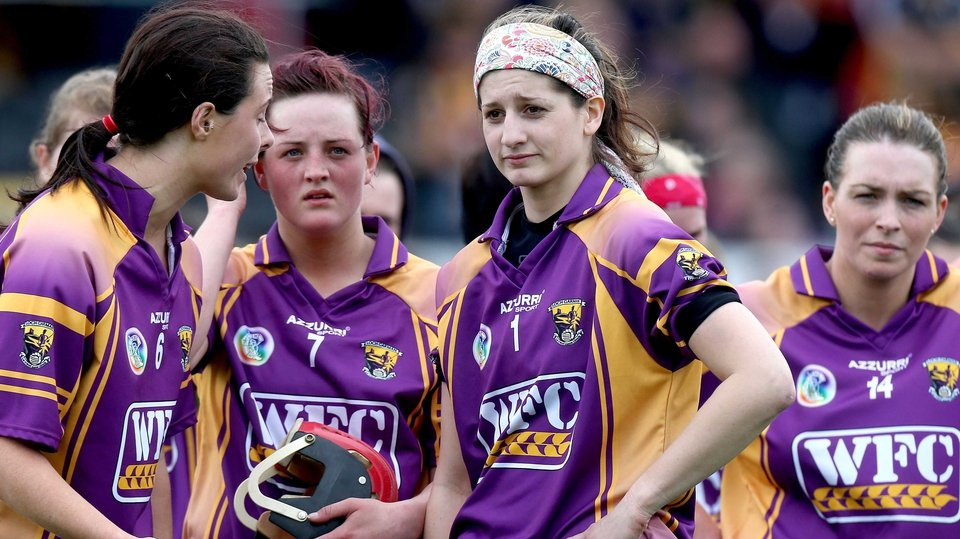 While Wexford's player commiserate with each other at the final whistle