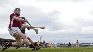 Antrim's Neil McManus scores a penalty past Westmeath goalkeeper Peter Collins and midfielder Eoin Price in Mullingar