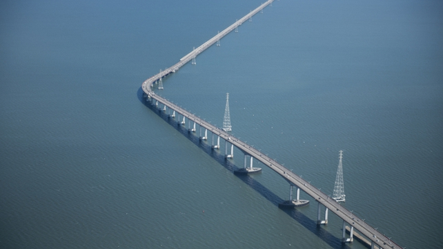 Five of the women were trapped, but the four other women managed to get out after the vehicle came to a stop on the San Mateo-Hayward Bridge