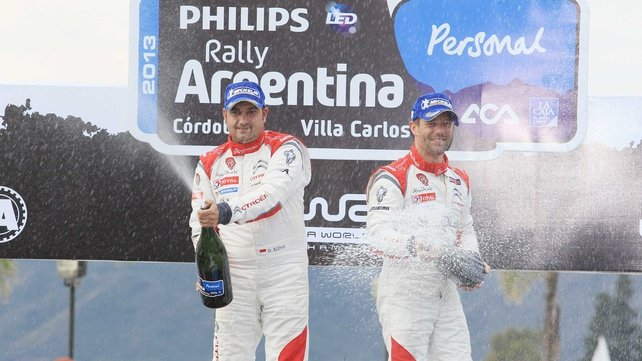 Sebastien Loeb (right) and Daniel Elena (left) celebrate their victory