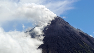 A sudden explosion of rocks, ash and plumes of smoke shook the mountain