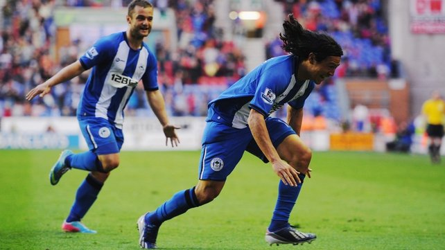 Roger Espinoza celebrates Wigan's opening goal against Swansea