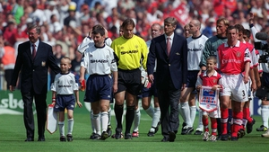Leading his team out alongside captain Denis Irwin and long-time rival Arsene Wenger for the Charity Shield in '99