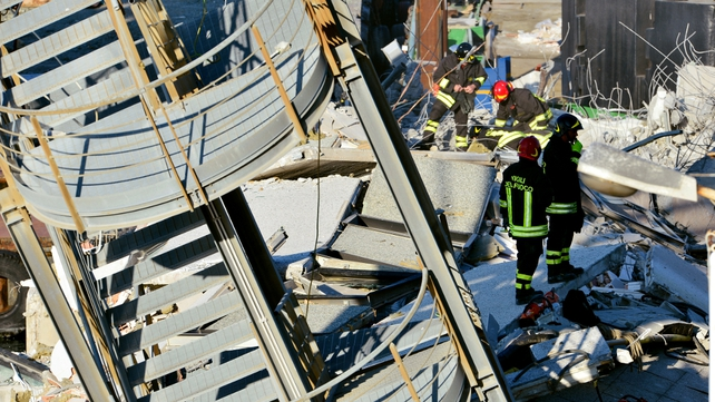 Rescue workers inspect the scene