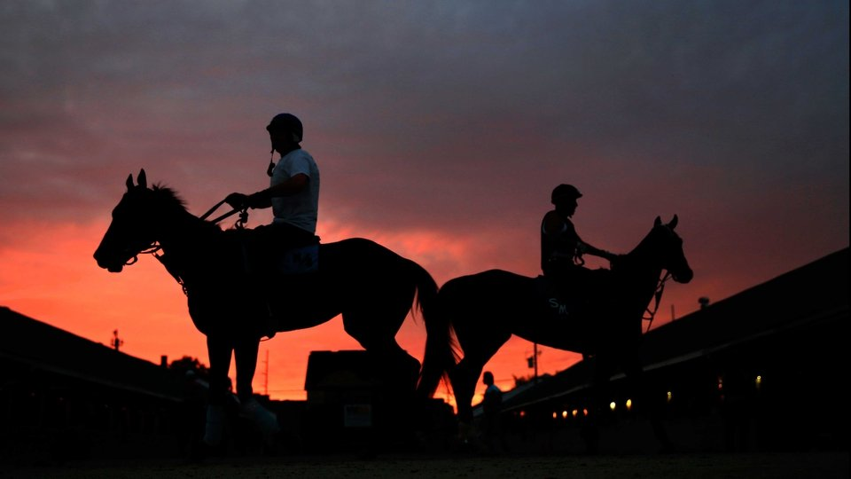 The sun rises during morning workouts for the Kentucky Derby at Churchill Downs in Louisville, Kentucky