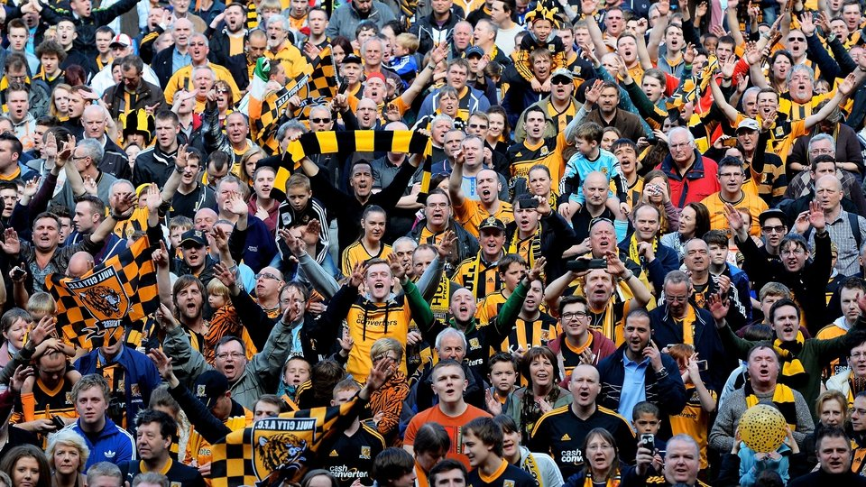 Hull fans invade the pitch to celebrate their team's promotion to the Premier League at KC Stadium