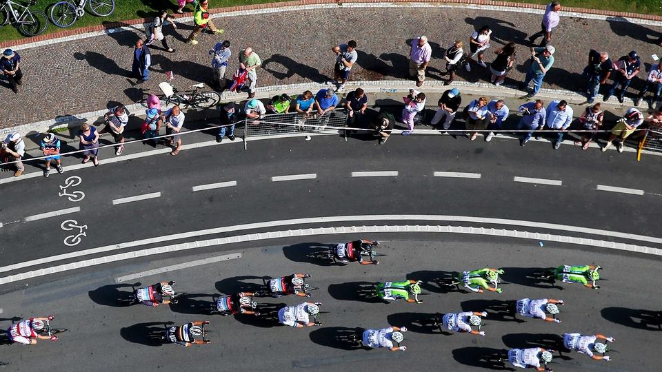 The Giro d'Italia peloton passes through Naples during stage one