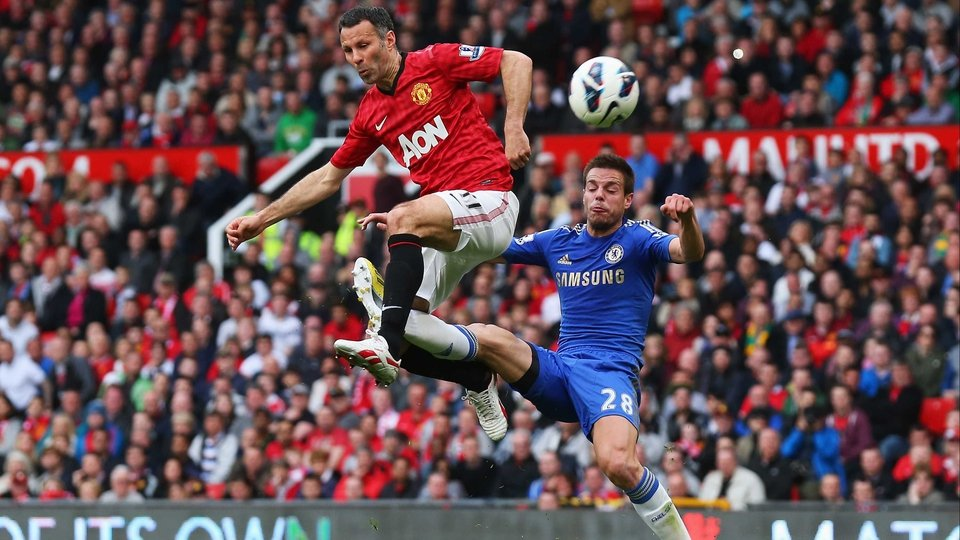 R yan Giggs of Manchester United is tackled by Chelsea's Cesar during the Premier League match at Old Trafford