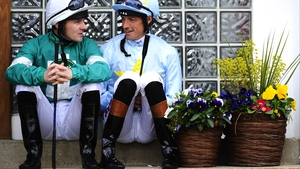 Ian Mongan (L) and Richard Hughes chat before the first race at Windsor racecourse