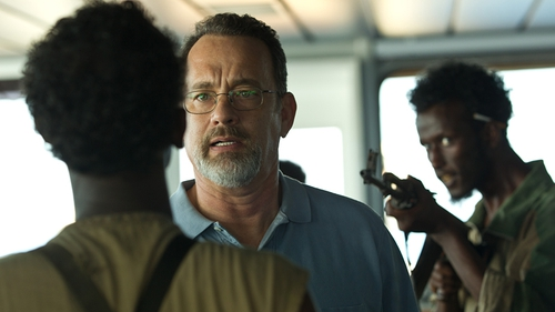 Hanks and Barkhad Abdi (left) in a scene from Captain Phillips