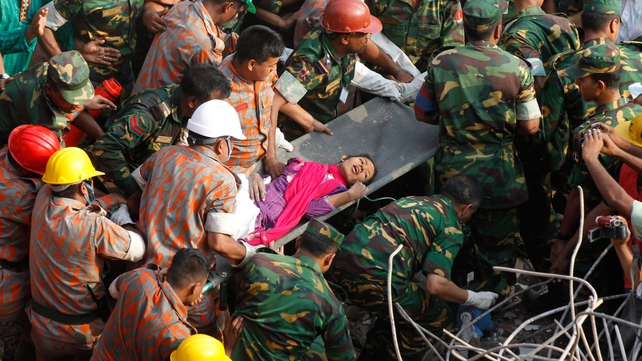 Bangladeshi rescuers retrieve garment worker Reshma from the rubble of the collapsed building in Savar