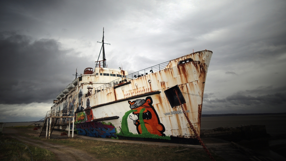 Former cruise ship the Duke of Lancaster in Flint, Wales, covered with graffiti as part of a project organised by local group Dudug