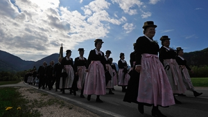 Villagers in Bavarian folk costumes participate in the annual Ascension Day procession in Unterwoessen