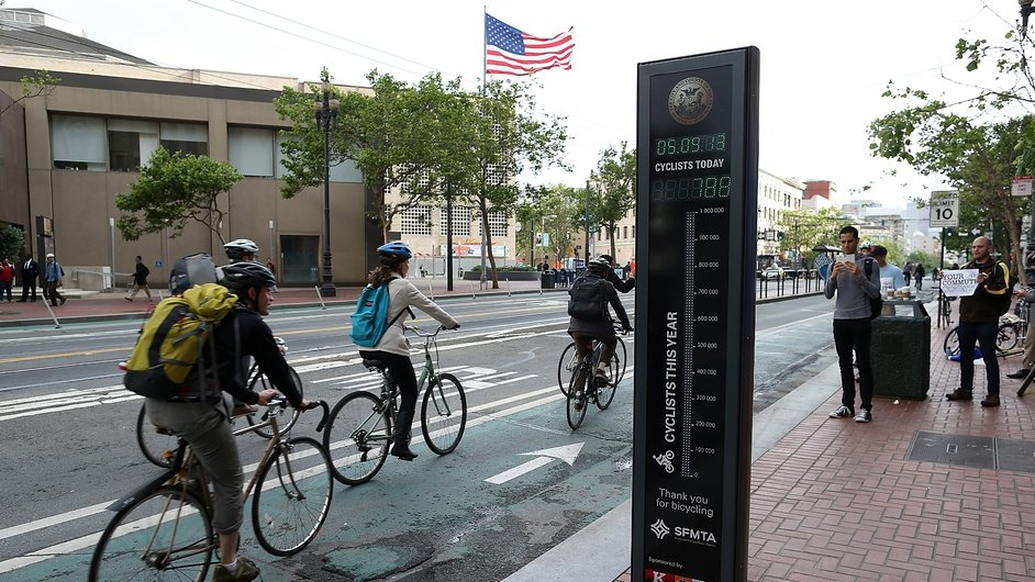 Cyclists in San Francisco pass a monitor which automatically counts the number of cyclist commuters