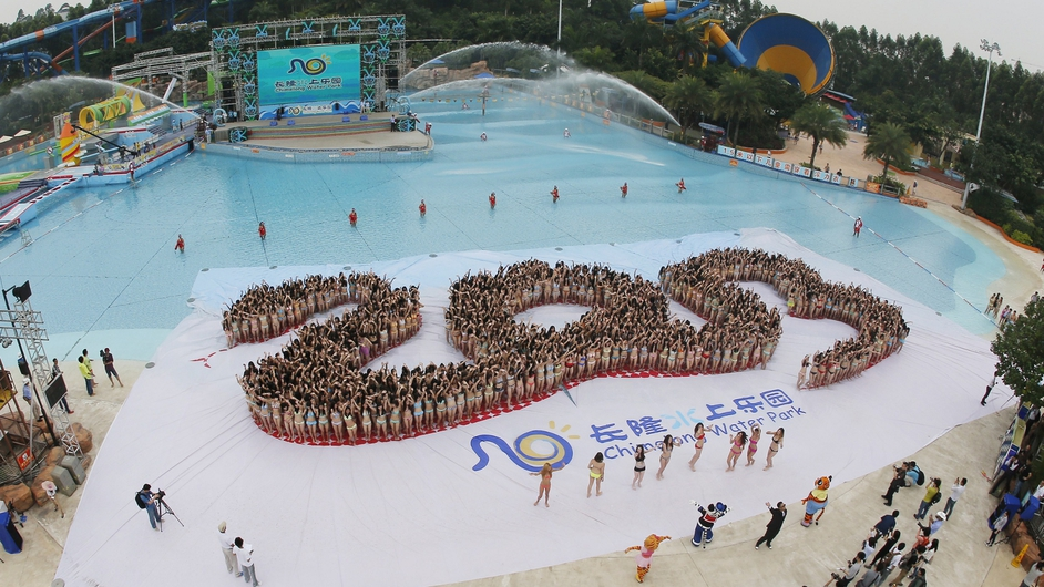 Thousands of women take part in a 'mass bikini gathering' in Chimelong Water Park in China