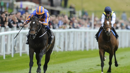 Magician (left) under Ryan Moore was an impressive winner of the Dee Stakes at Chester