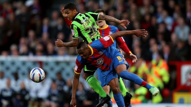 Kagisho Dikgacoi of Crystal Palace is challenged by Liam Bridcutt of Birghton