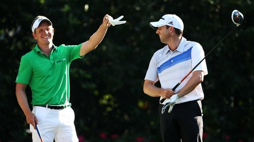 Leader Sergio Garcia (right) shares a joke with Luke Donald during the second round at Sawgrass