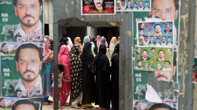 Pakistanis streamed to the polls to vote in a historic election pitting a cricket star-turned-politician against an unpopular incumbent and a two-time prime minister