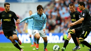 Action from the 2013 Cup final involving Wigan and Man City