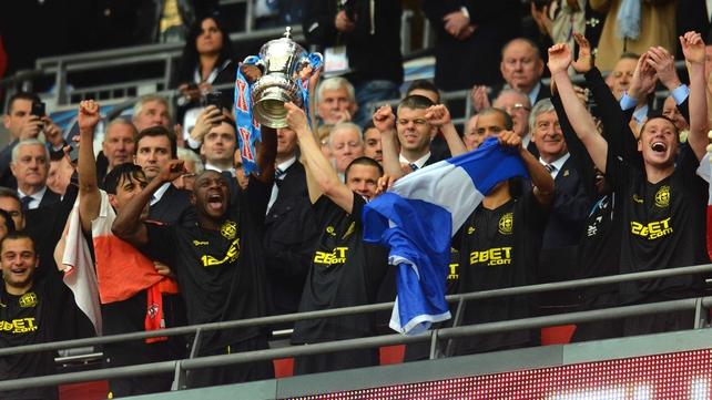 Wigan celebrate winning last year's FA Cup