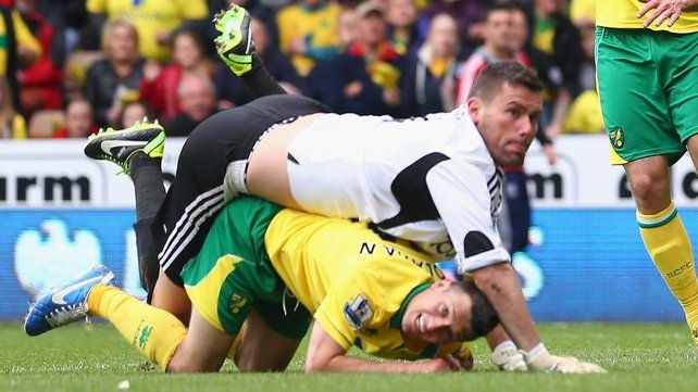 Ben Foster of West Brom tangles with Wes Hoolahan of Norwich City