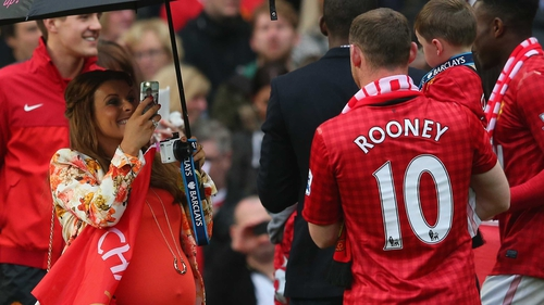 Wayne Rooney has his picture taken by his wife Coleen following the Barclays Premier League match between Manchester United and Swansea