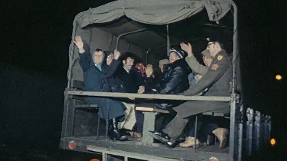 Commuters in army lorry during bus strike (1979)