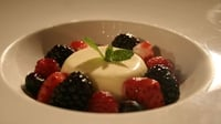 Vanilla panna cotta, fresh berries and strawberry consommé - A light and Summery sweet from Bon Appetit's Oliver Dunne